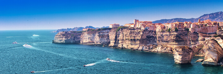 Bonifacio town on beautiful white rock cliff with sea bay, Corsica, France, Europe.