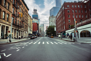 New York City street road in Manhattan at summer time. Urban big city life concept background.