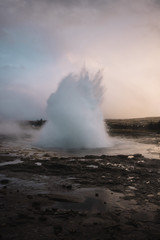 Beautiful geyser valley in Iceland.Erupting geyser