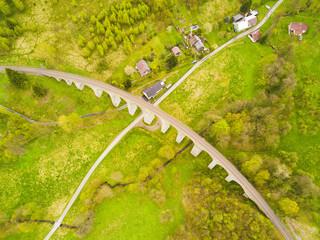 Aerial view of old railway stone viaduct. Tourist attraction in Krystofovo Udoli (Christofsgrund), Novina, Czech republic. Famous historical viaduct in Liberecky kraj, European union.