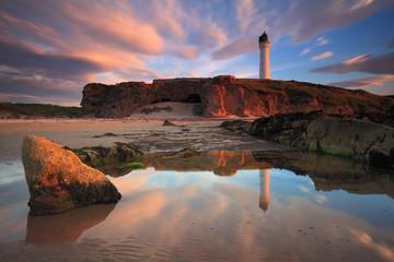 Amazing sunset over Lossiemouth lighthouse (Scotland UK)
