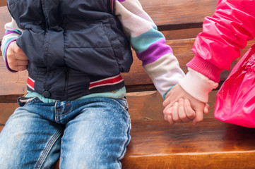 children Girl and boy holding hands