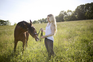 Blonde Female with a Horse in Rural Virginia