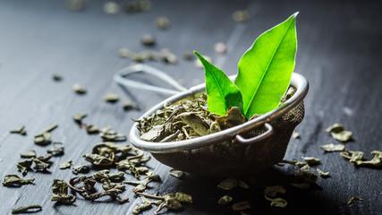 Fresh green tea on black wooden table