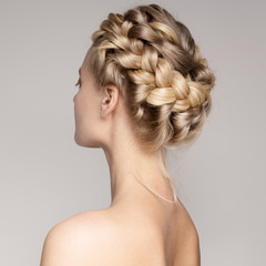 Portrait Of A Beautiful Young Blond Woman With Braid Crown Hairstyle.