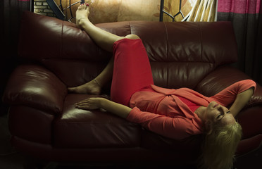 A young woman lying on the couch