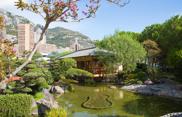 Monaco, Monte Carlo. Jardin Japonais, Japanese Garden view with residential buildings at the background.