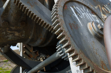 a rusty Weathered cog mechanism inside part of an industrial machine.