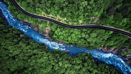 Aerial view of Mountain river and road. Mountain gorge