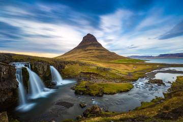 Kirkjufellsfoss waterfall with Kirkjufell mountain in the background at sunset, Iceland