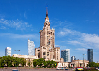 Warsaw city center with Palace of Culture and Science (PKiN), a landmark and symbol of Stalinism and communism, and modern sky scrapers.