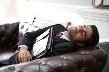 Businessmen are fatigue from work, are sleeping.