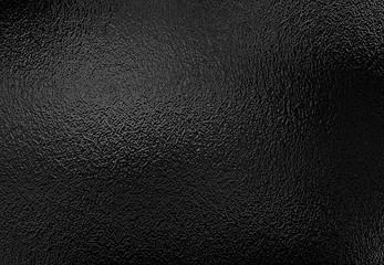 Tekstura tło błyszcząca czarna metalowa folia