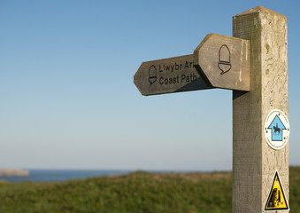 Pembrokeshire coast path sign with a clear blue sky and potential copy space