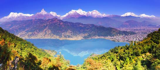 Pokhara valley, Phewa lake and the magnificent Annapurna mountain range from hillside. Himalayas, horizontal panoramic view