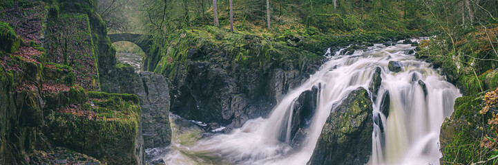 Panoramic view of the Black Linn Falls on the River Braan in the Hermitage woodland. Perthshire, Scotland, UK