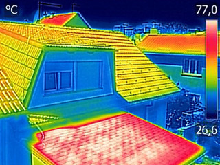 Infrared thermovision image showing Warmed roofs on family homes