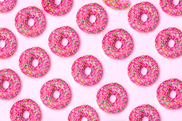 isometric. Pink donut pattern on a pink background