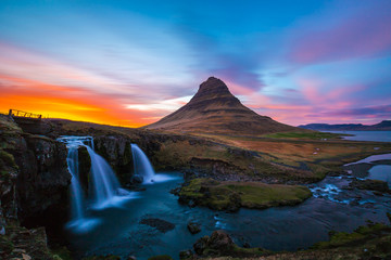 Kirkjufell Church mountain at sunset with pink and orange skyline, Iceland