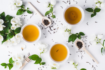 Green tea with a jasmine in white cups