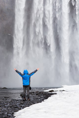 One man posing at Skogafoss waterfall in Iceland