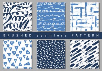 Set of Vector colorful seamless pattern with brush strokes and dots. Blue color on white background Hand painted grange texture. Ink geometric elements. Fashion modern style Unusual kid school collage