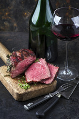 Barbecue Wagyu Point Steak with a Glass of Red Wine as close-up on an old metal sheet