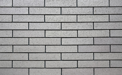 Horizontal grey brick wall background.