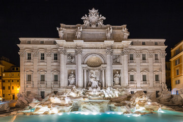 Night view of the most famous architectural landmark - Trevi Fountain in Rome, Italy.