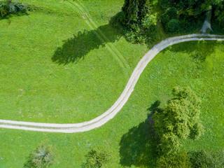 Aerial view of path through fields