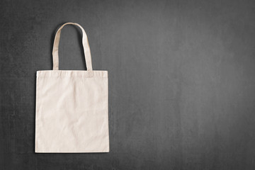 Tote bag fabric cloth shopping sack mockup isolated on black chalckboard copyspace (clipping path)