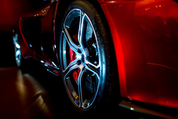 Close Up on beautiful modern supercar with dramatic lighting