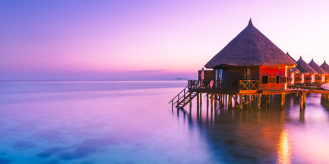 Water bungalow. Sunset on the islands of the Maldives. A place for dreams.
