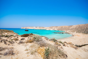 Amazing view of Koufonisi island with magical turquoise waters, lagoons, tropical beaches of pure white sand and ancient ruins on Crete, Greece