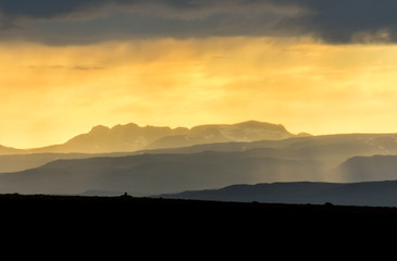 Colorful sunset over mountains. Fantastic view of layered icelandic landscape. Iceland.