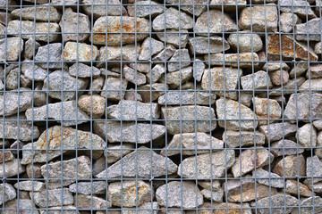 Moderner Metall-Stein-Zaun als Hintergrund