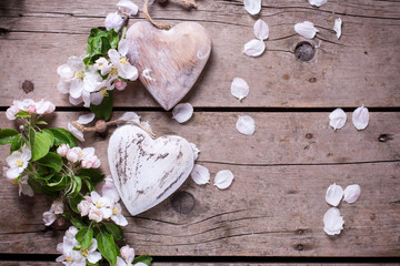 Two decorative hearts and apple tree flowers