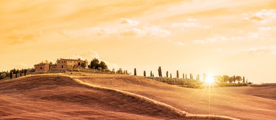 Beautiful typical panorama landscape of Tuscany at sunset, Italy