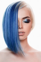 woman with blue hair and make-up