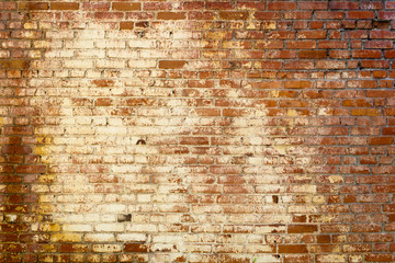 Old colored brick wall texture grunge background