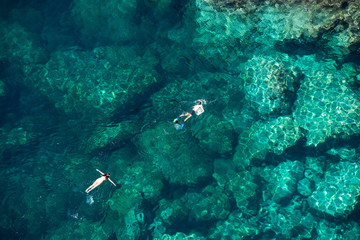 Couple snorkeling in the sea