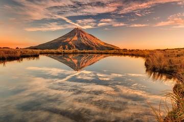 Relexion of Mt Taranaki in New Zealand at sunset