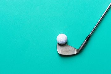 golf ball and golf club on green background