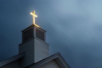 Lit Church Cross with Dramatic Clouds