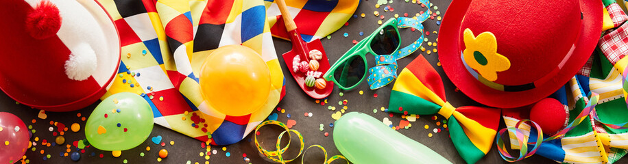 Colorful carnival banner with party accessories