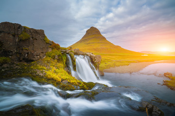 Beautiful of Kirkjufellsfoss waterfall with Kirkjufell mountain in the background on the north, Iceland