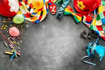 Border of rainbow colored carnival accessories