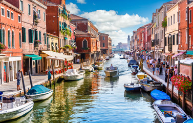 Island murano in Venice Italy. View on canal with boat
