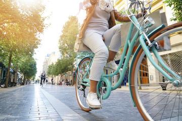 Senior woman riding city bike in town