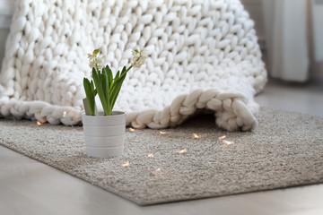 White scandinavian interior with knit plaid.